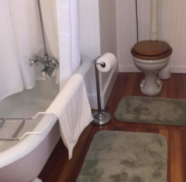 Claw foot tub, and high tank toilet